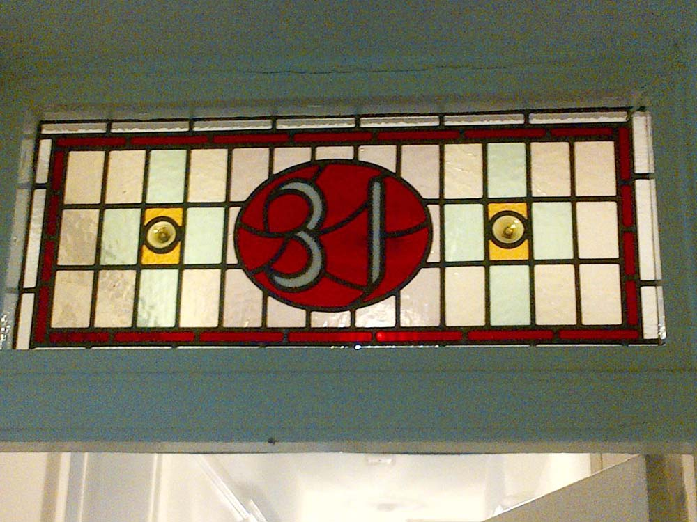 number 31 stained glass window