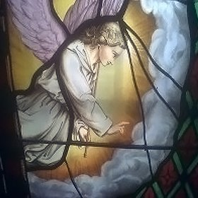 Detailed stained glass window of angel